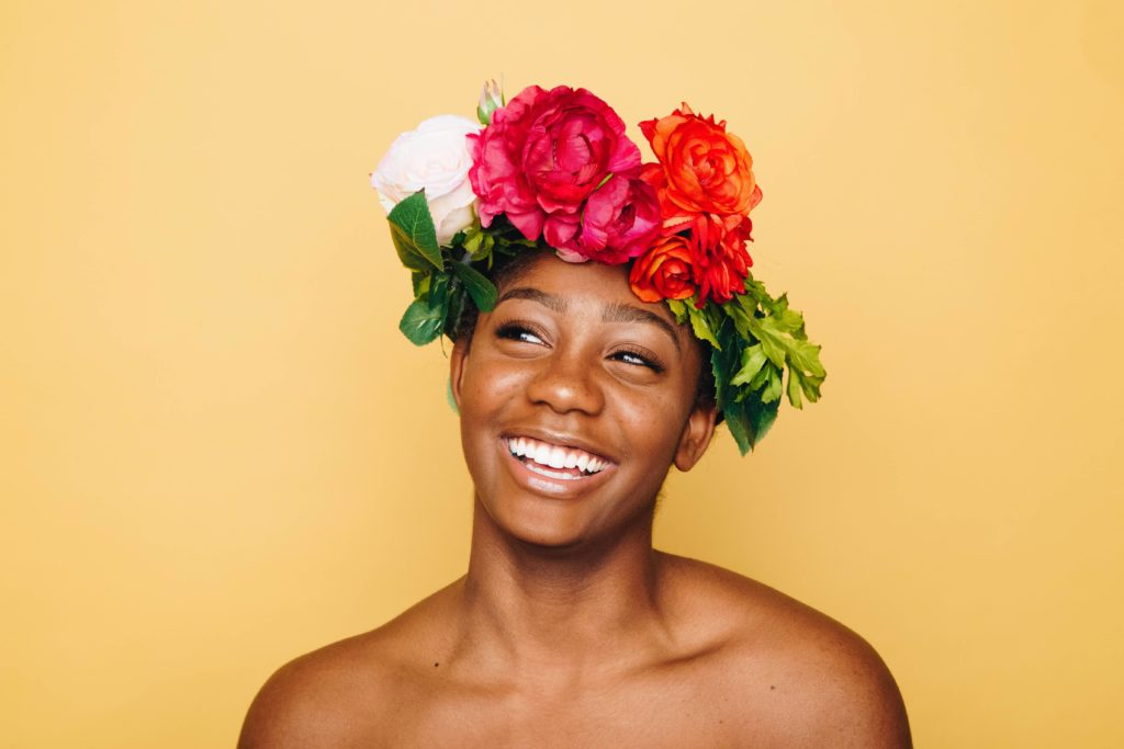 woman of color with flower crown